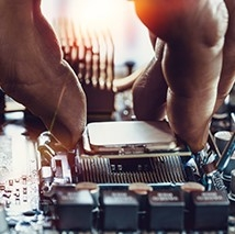 Hand installing a CPU into a motherboard