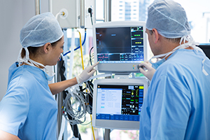 Surgeons using a medical computer during surgery