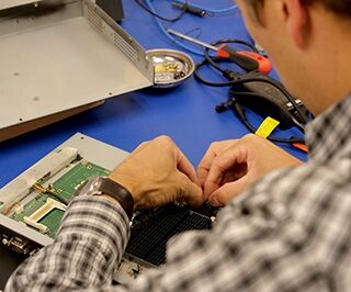 Teguar service technician fixing an industrial computer