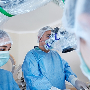 Two surgeons using a robotic surgery machine