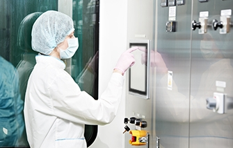 Cleanroom technician using a touchscreen industrial computer