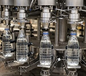 Industrial machine in a factory that fills water bottles
